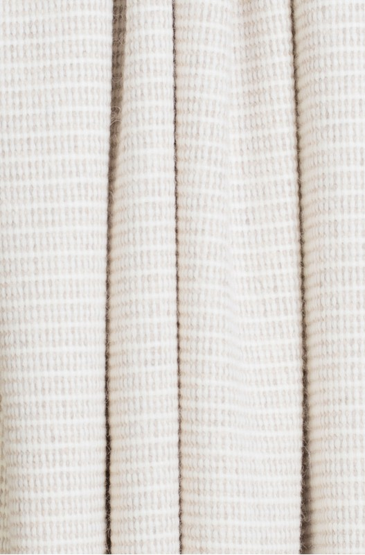 Geweven beige plaid van alpaca wol voor je interieur